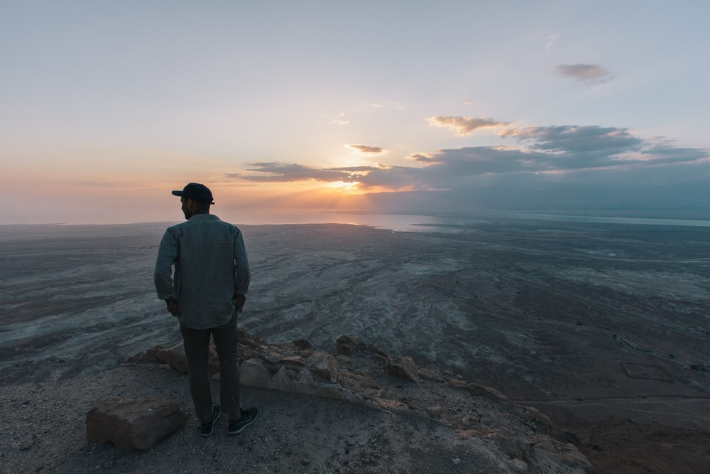 man looking at land