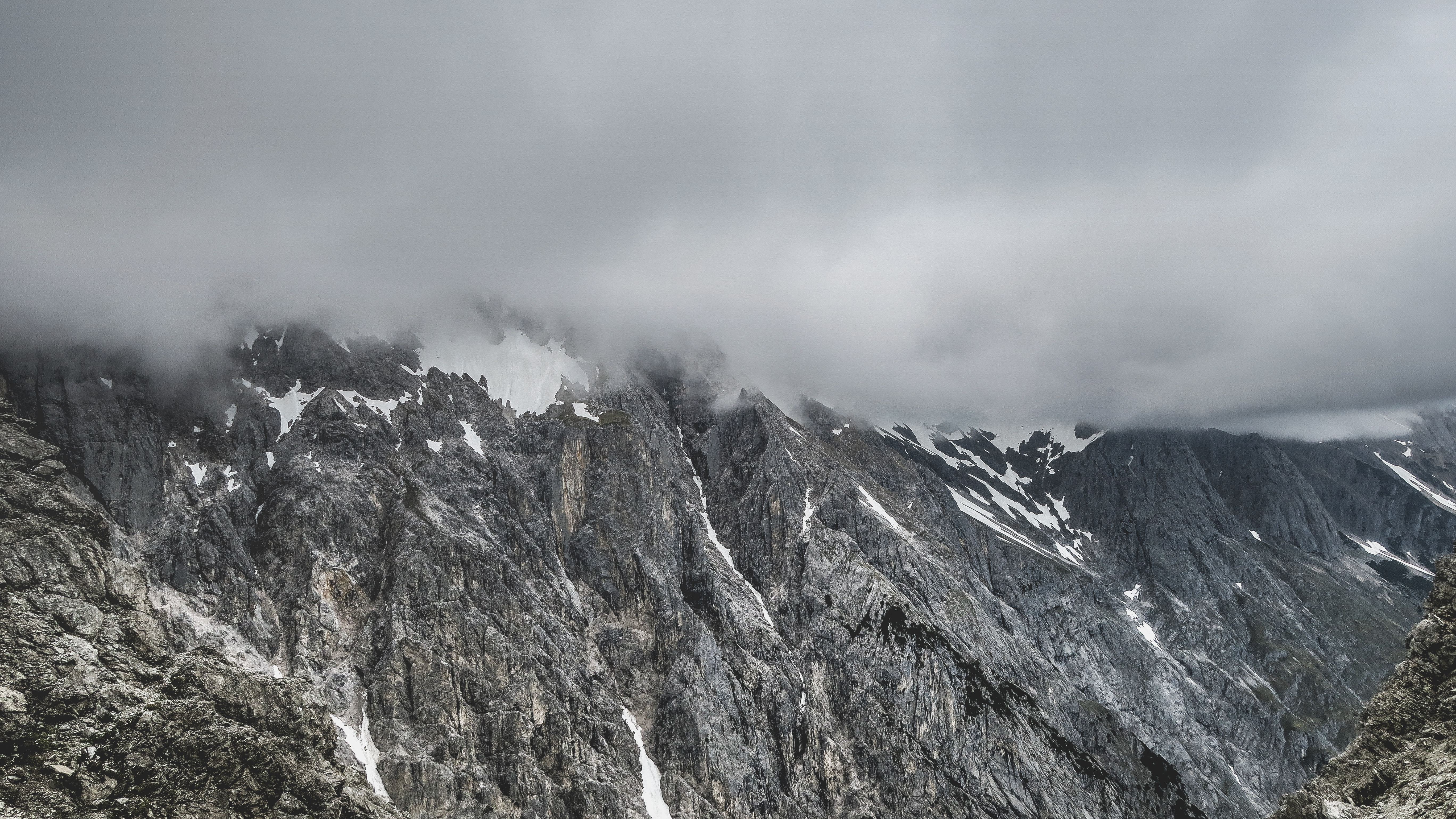 Fog covers the mountain tops of Wankspitze in Tyrol, Austria