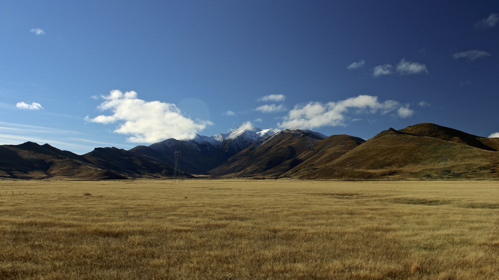 photo of grass field and mountains