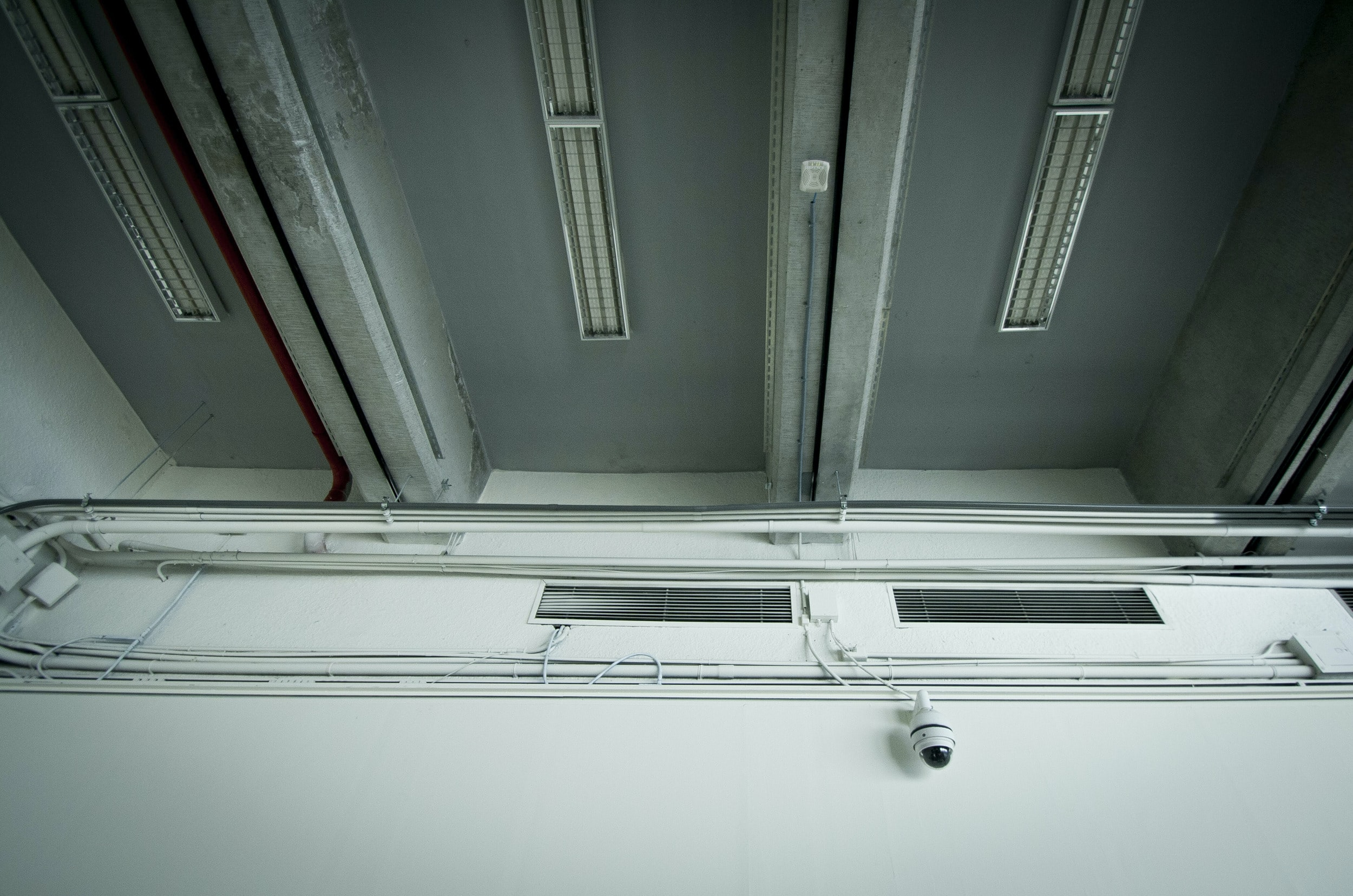 white CCTV camera on white wall