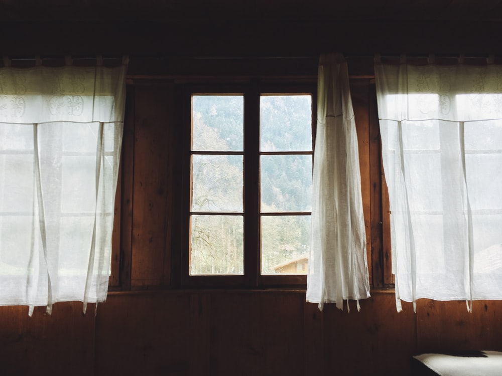 clear glass window with cutrain