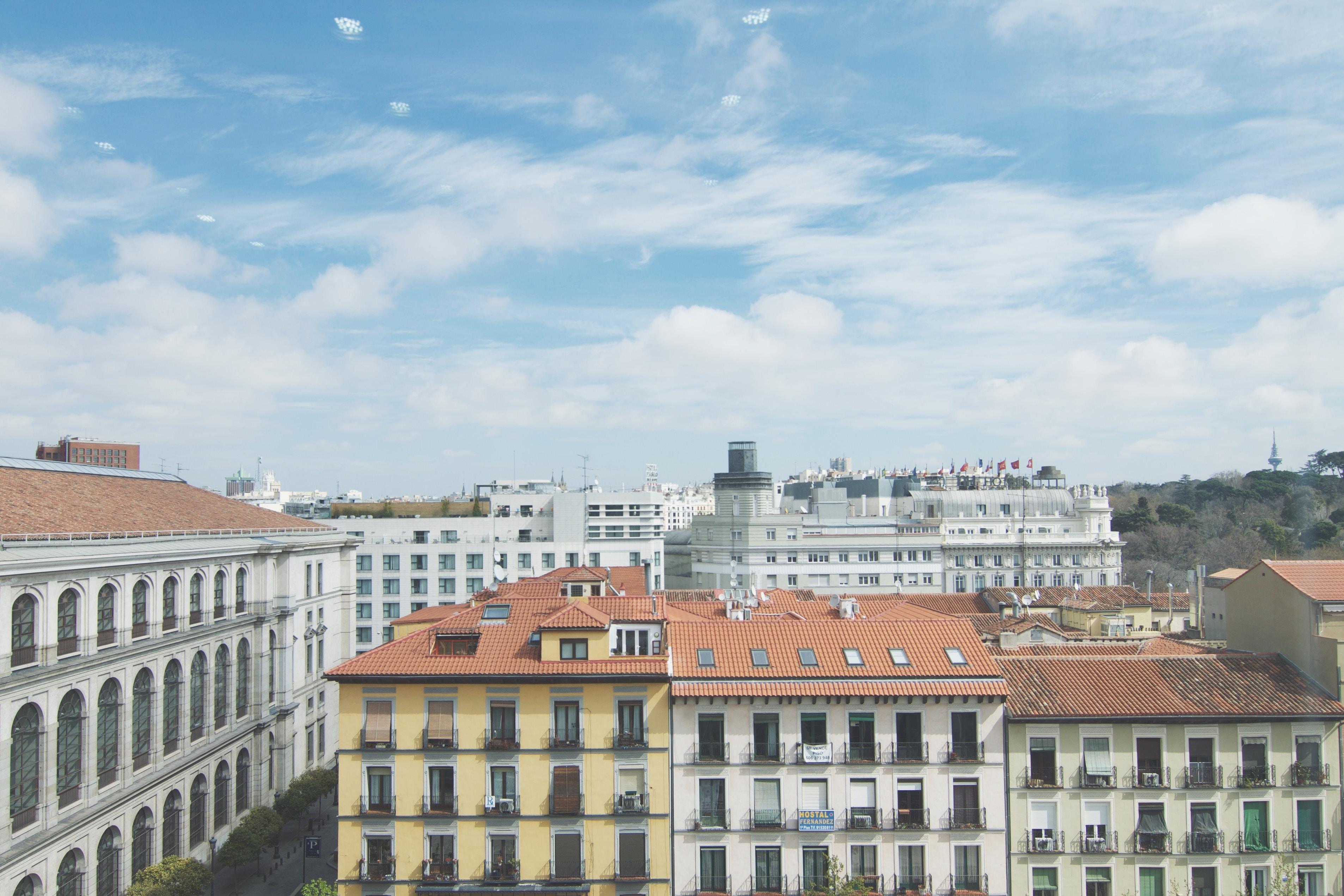 Long shot of blue sky and downtown building architecture, Museo Nacional Centro de Arte Reina Sofía