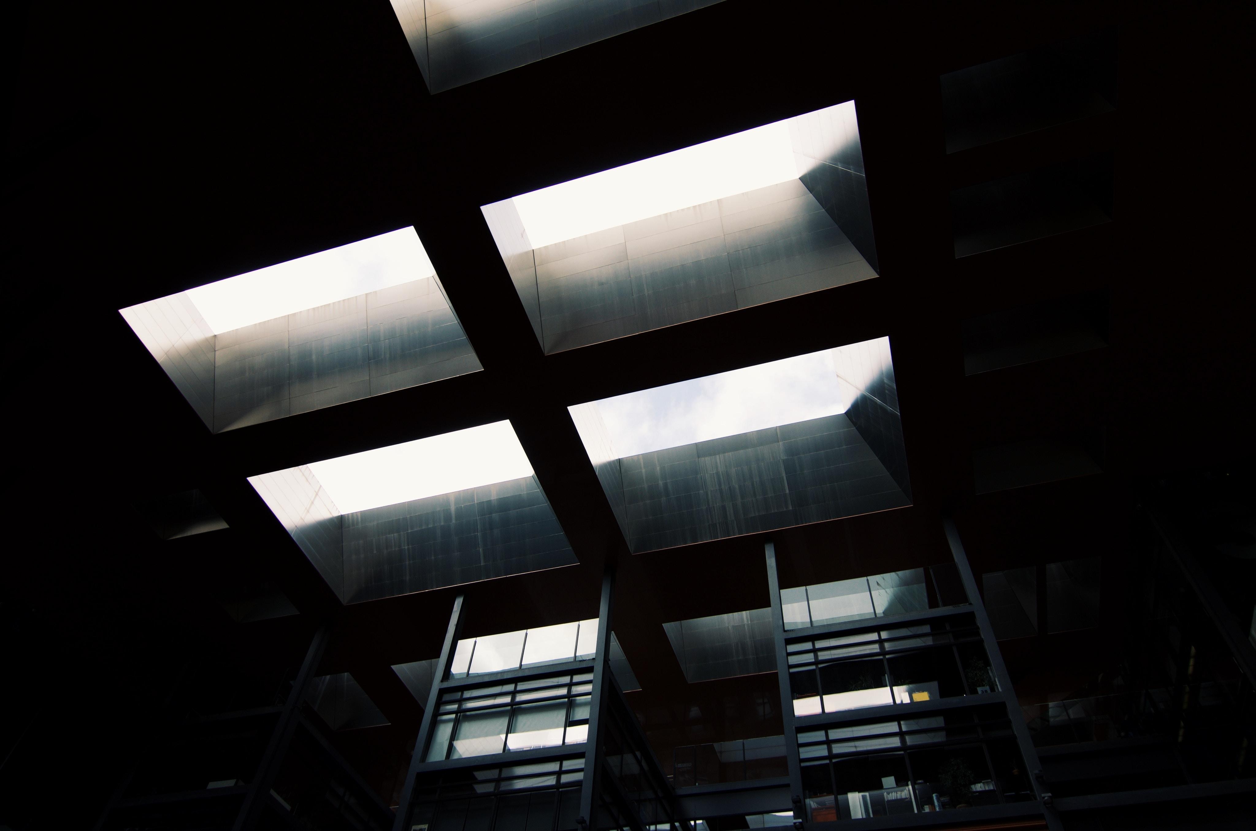 Skylight window from below in dark industrial room at Museo Nacional Centro de Arte Reina Sofía