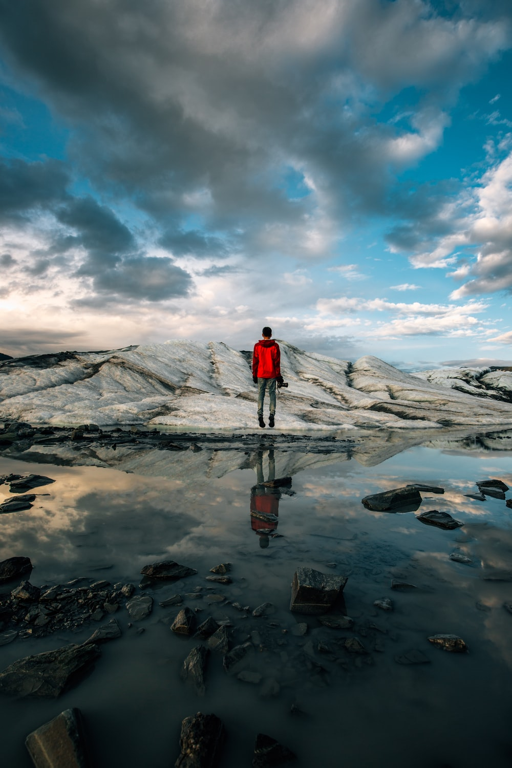 man standing near body of water of water