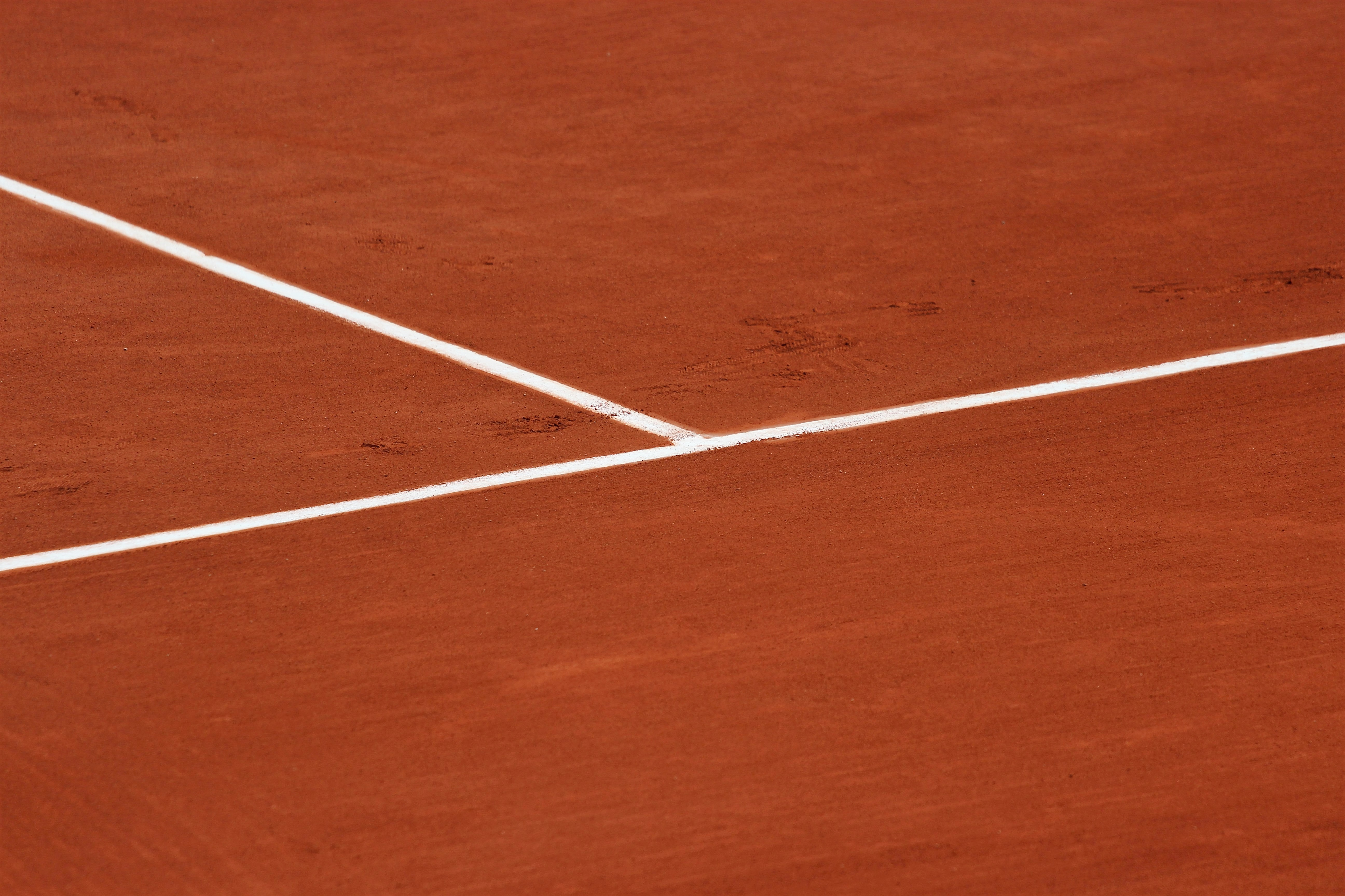 The view of a white tennis line markings on a tennis court
