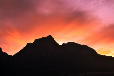 silhouette of mountain peak south africa teams background