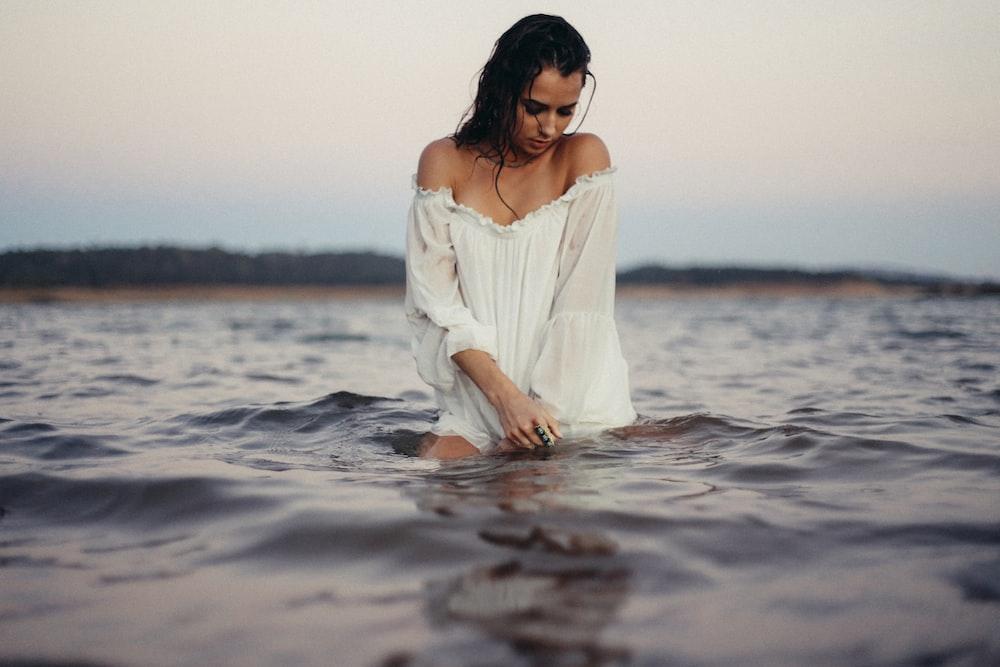 woman posing in body of water