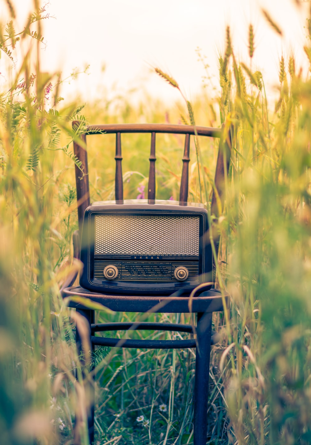 black transistor radio in the middle of the field