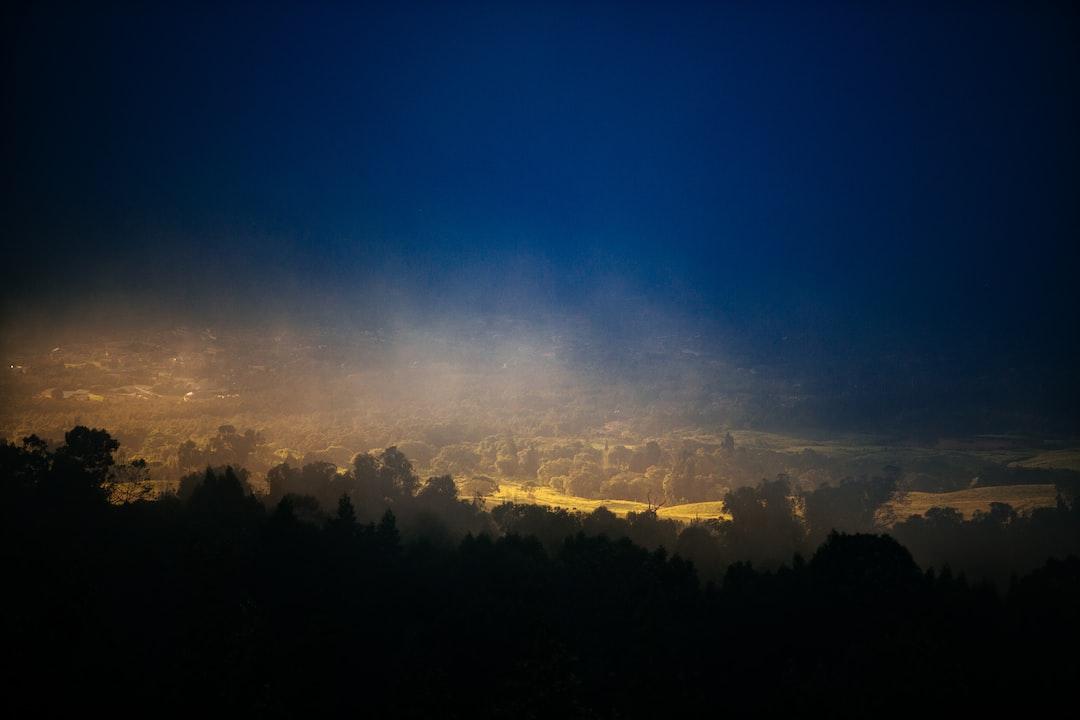 Countryside under a dark cloud