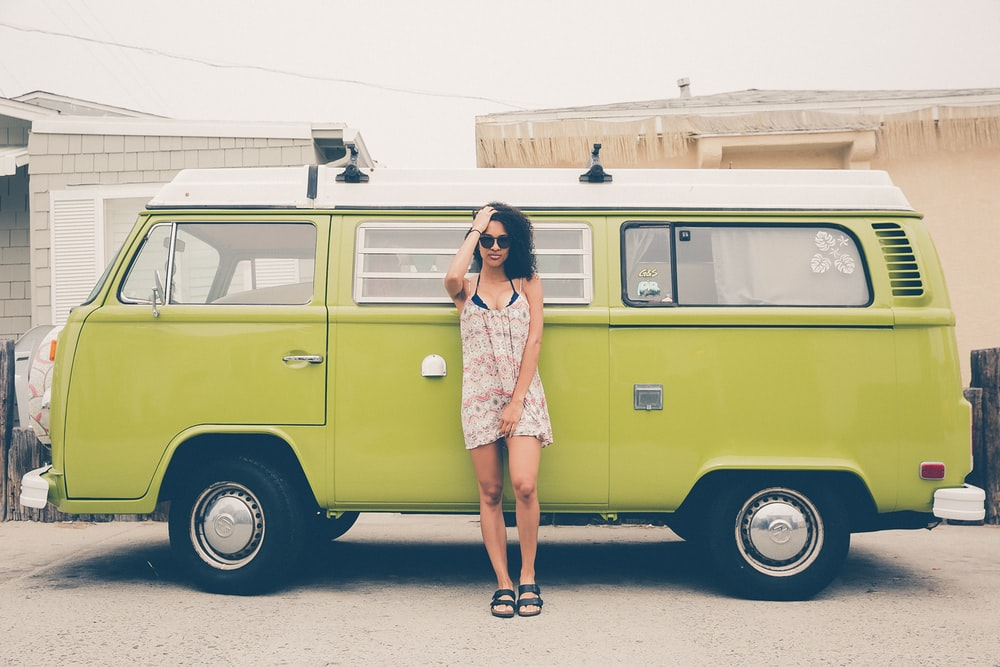 woman leaning on green bus