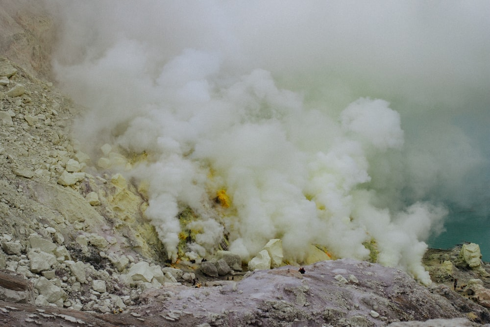 mountain covered by smoke