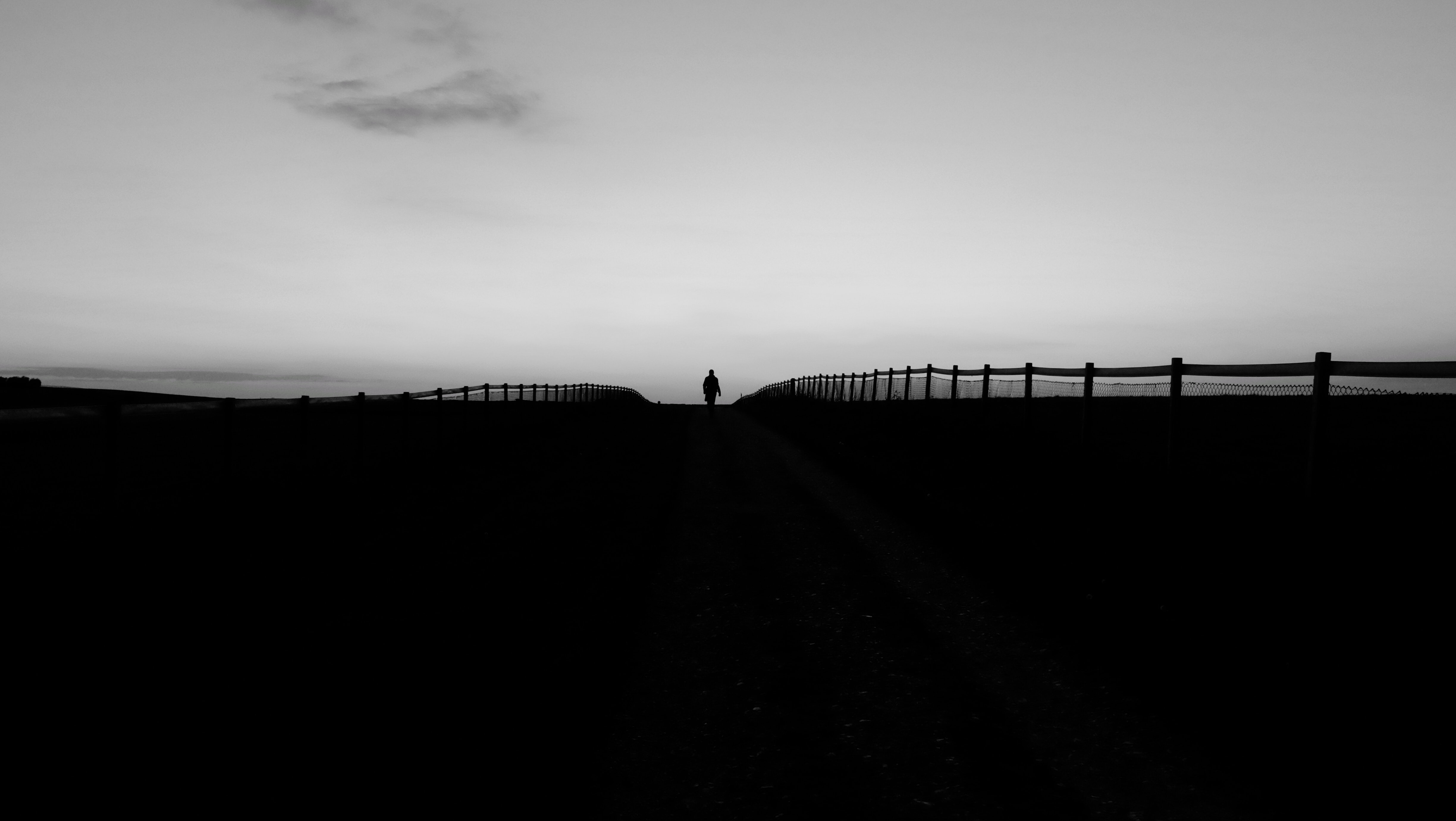 silhouette of person on road