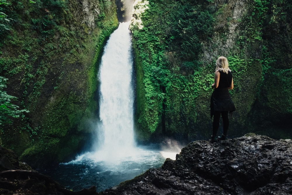 woman in front of waterfalls
