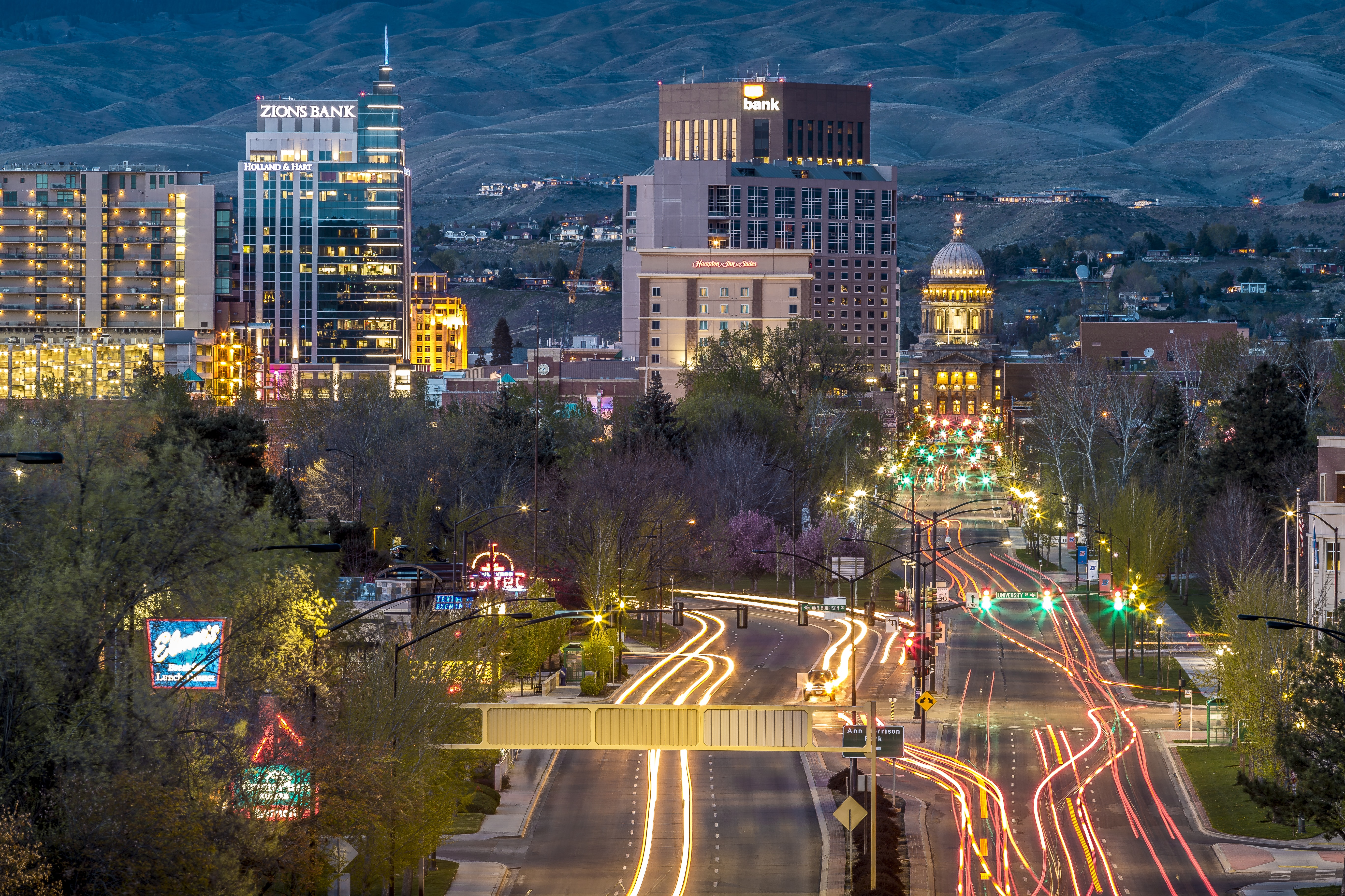 Long shot time lapse of urban traffic and skyscrapers in Boise at night