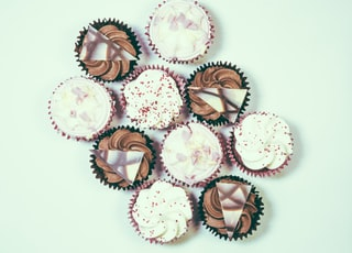 assorted cupcake lot on white surface