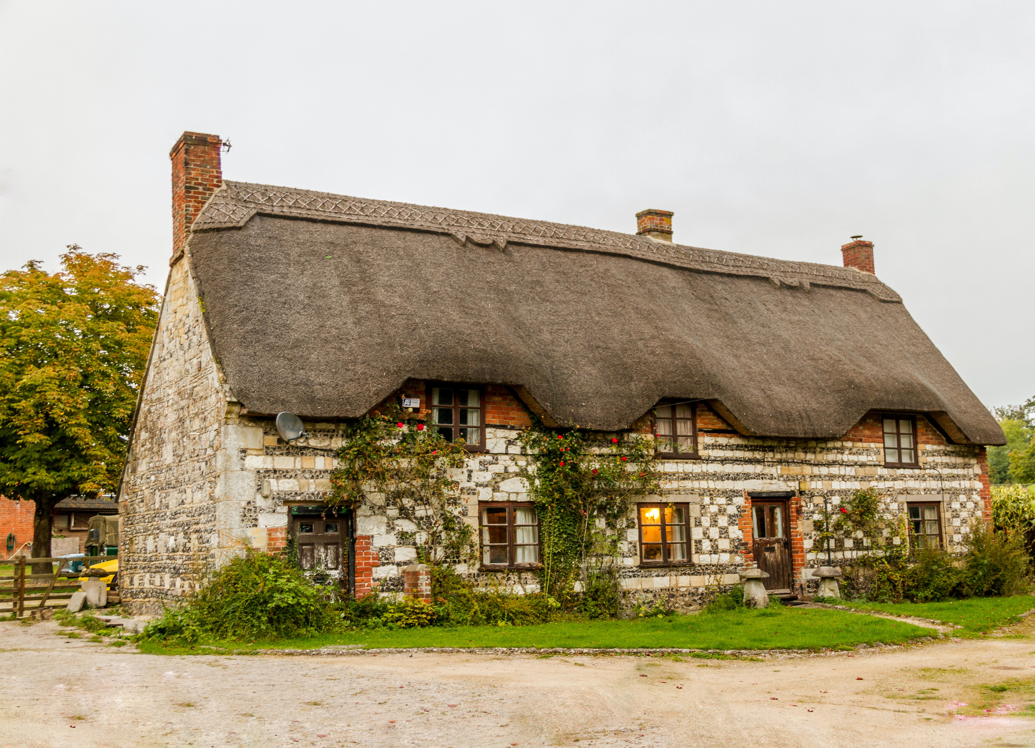 Cozy country cottage with thatched roof in England