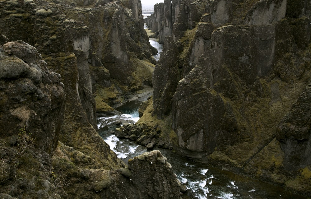 rocky terrain with river in middle