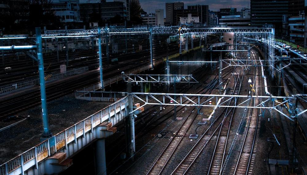 blue lighted bridge near railways
