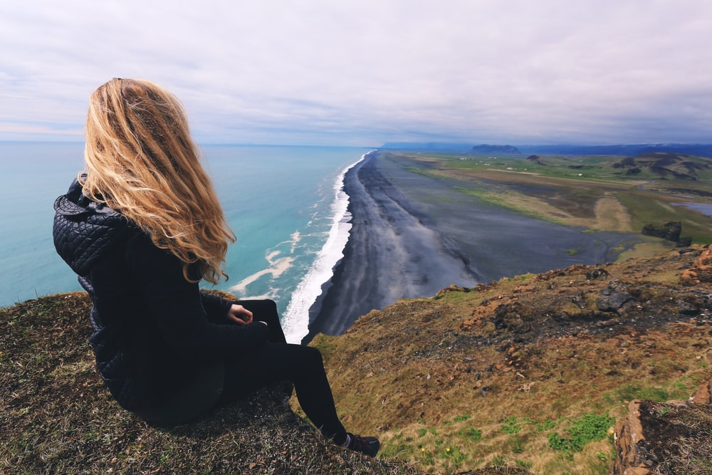 woman looking at seashore