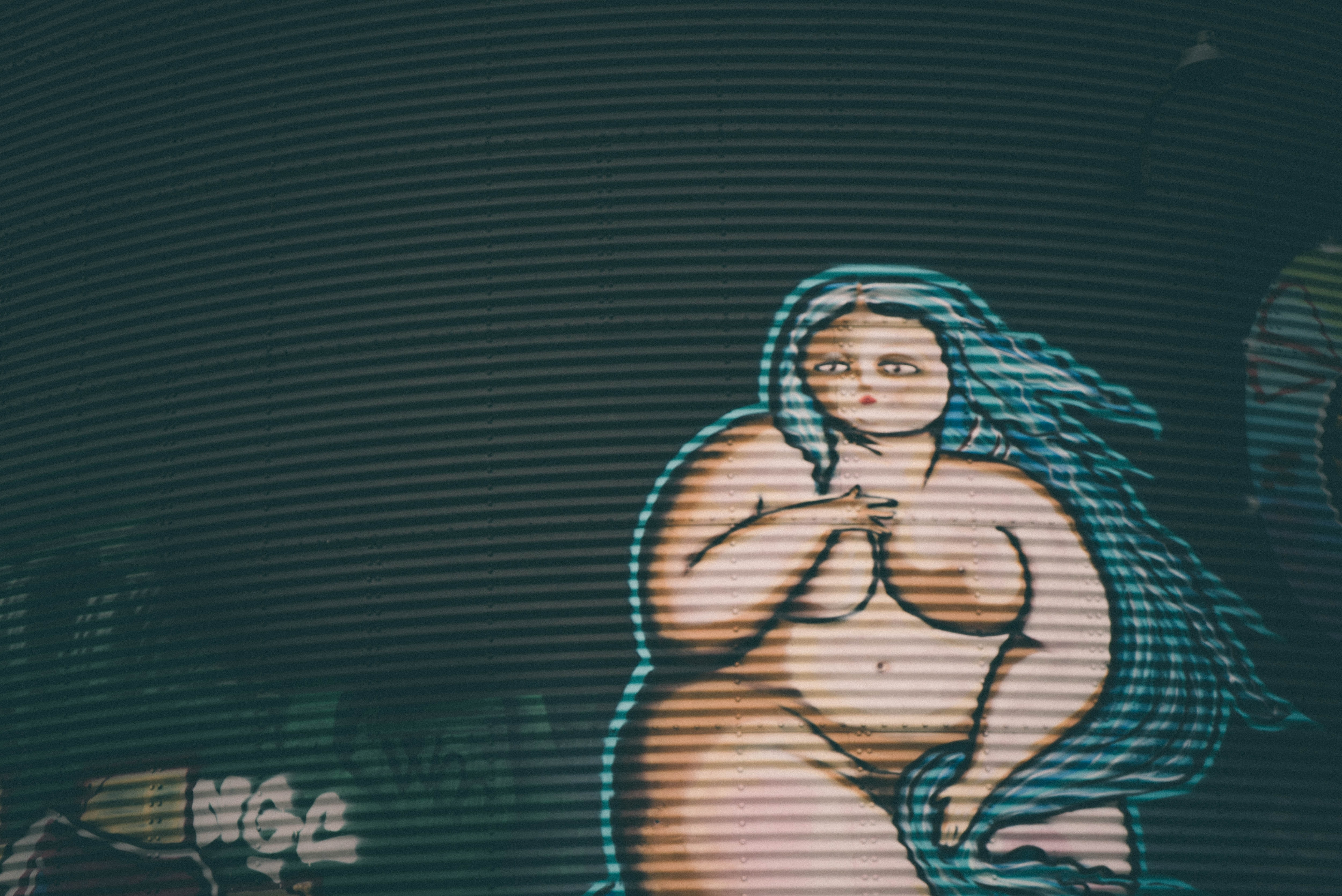 A naked animated BBW painted on a wall.
