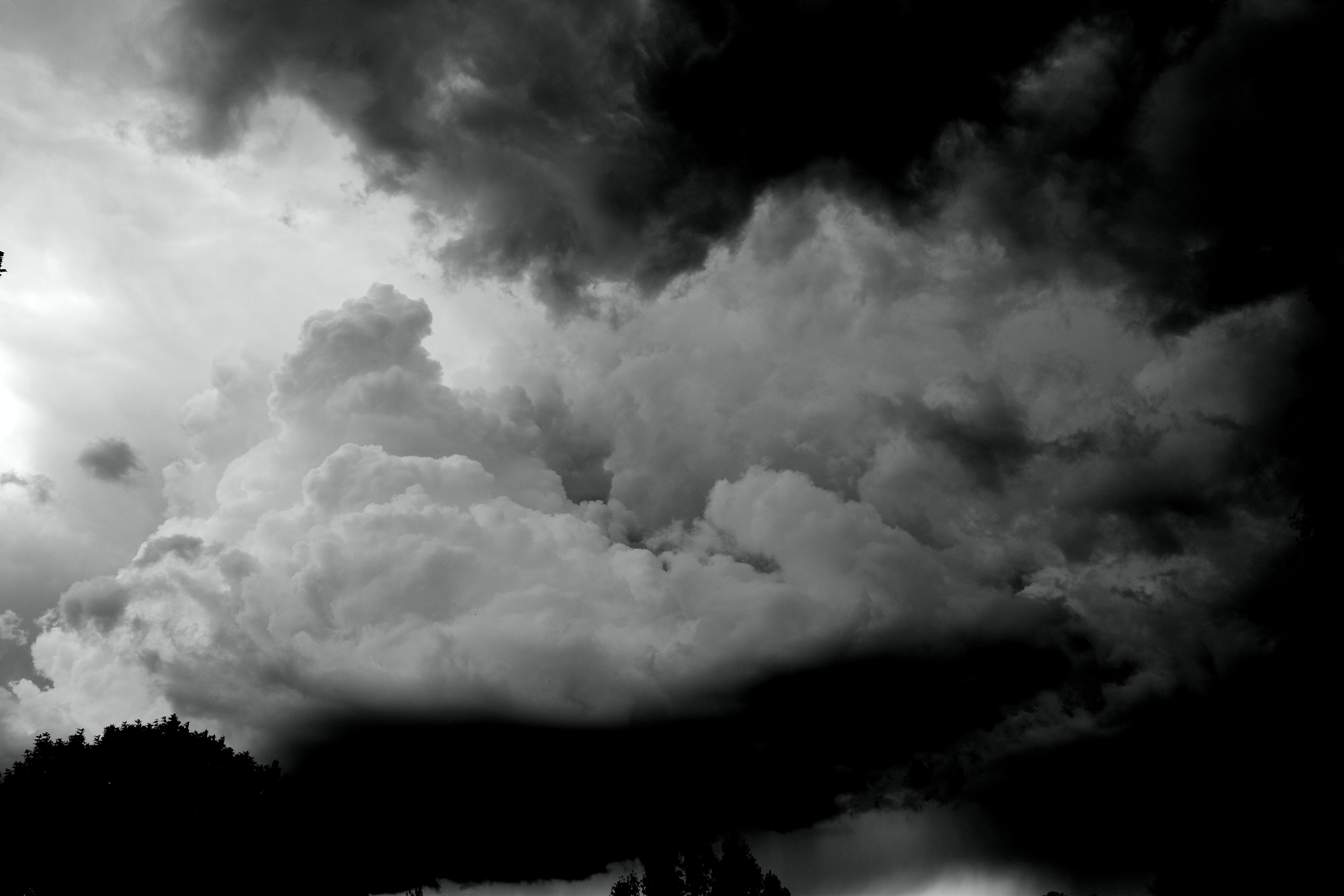 A black and white photograph of storm clouds