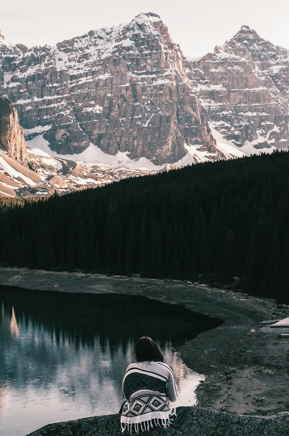 woman at the peak of peak mountain