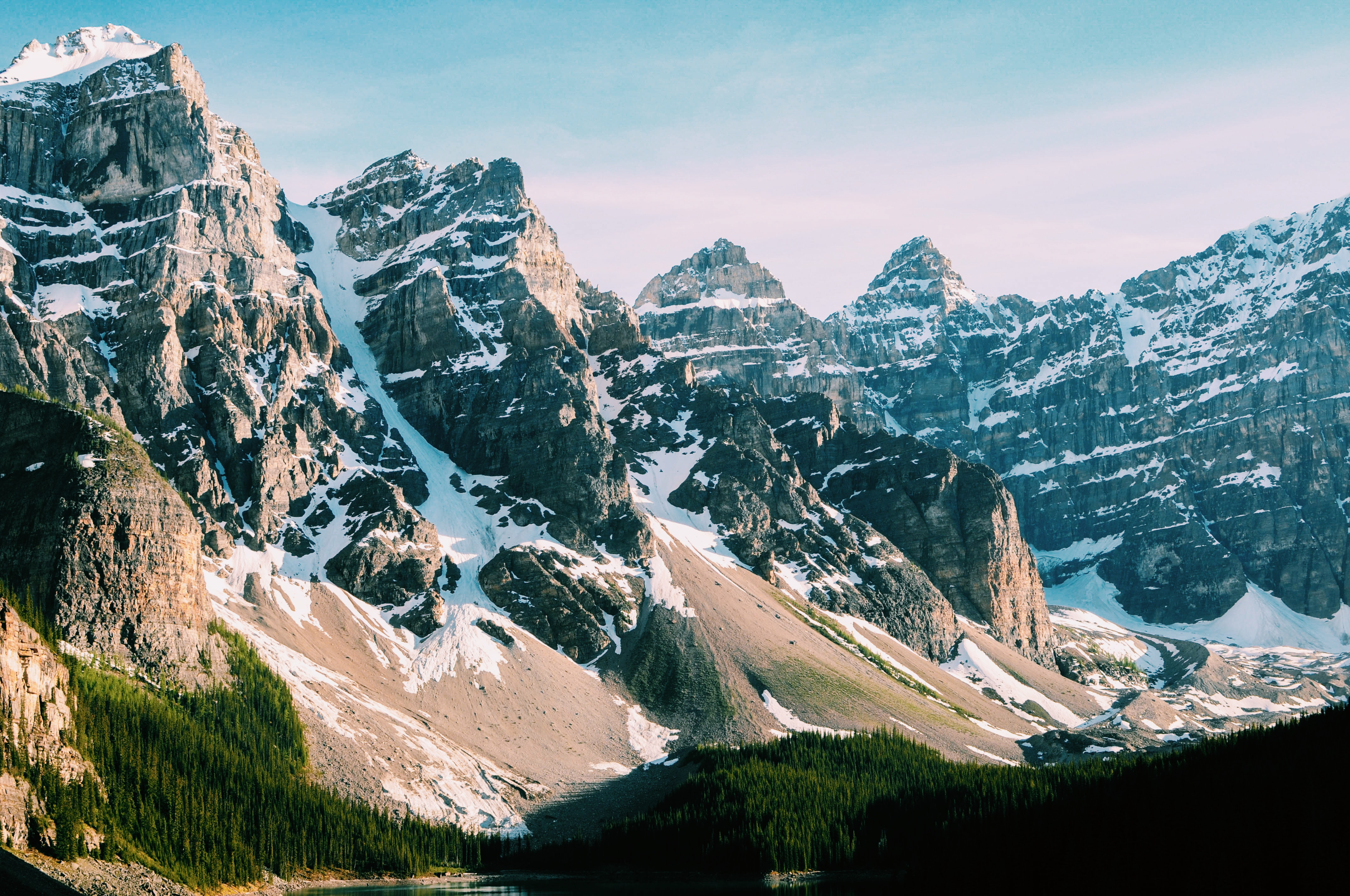 Moraine Lake and the surrounding forests and snowy mountain ridges
