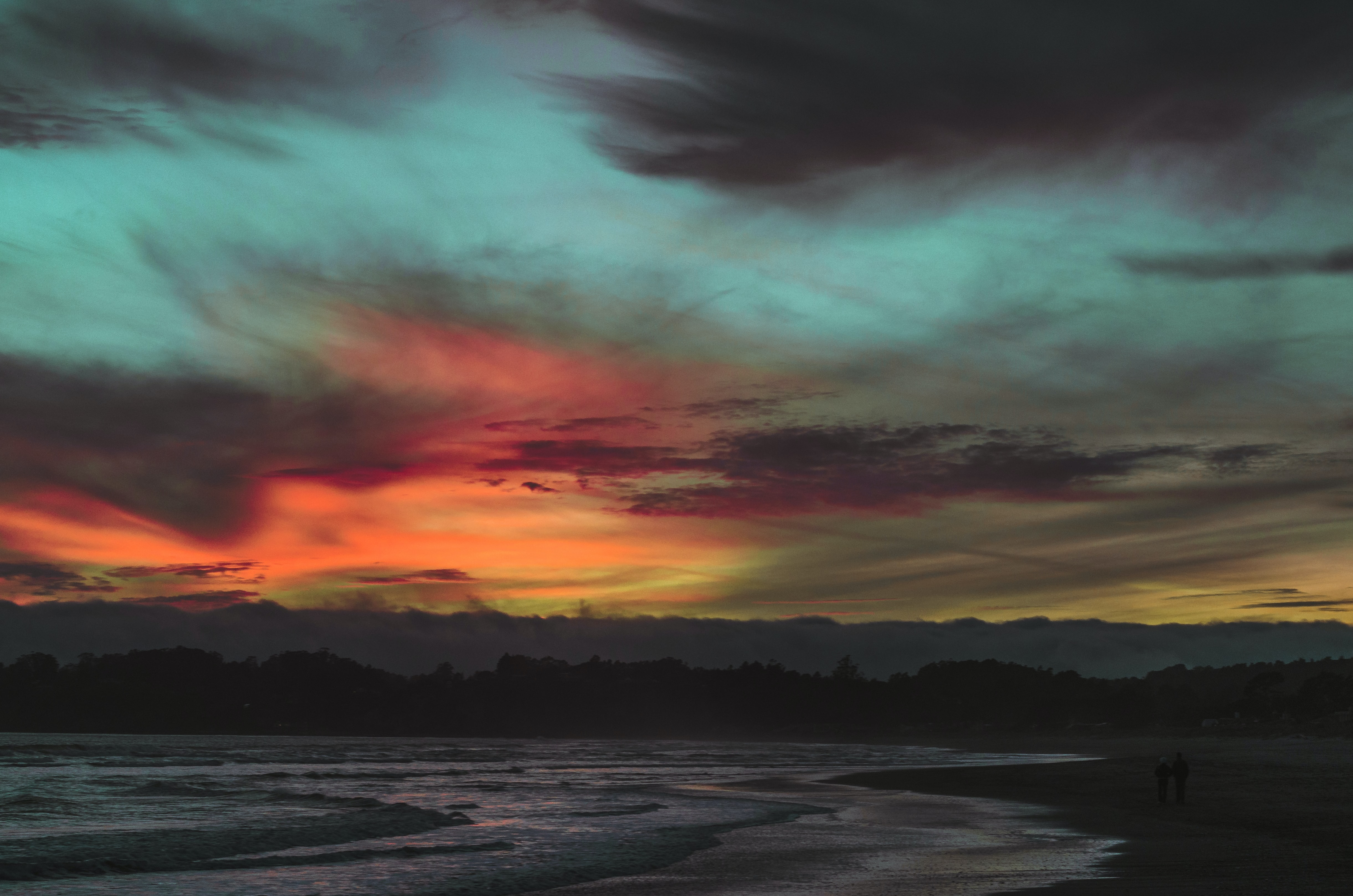 Colorful skies after sunset above the sand beach coastline at Stinson Beach