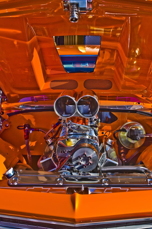 chrome engine bay in orange car