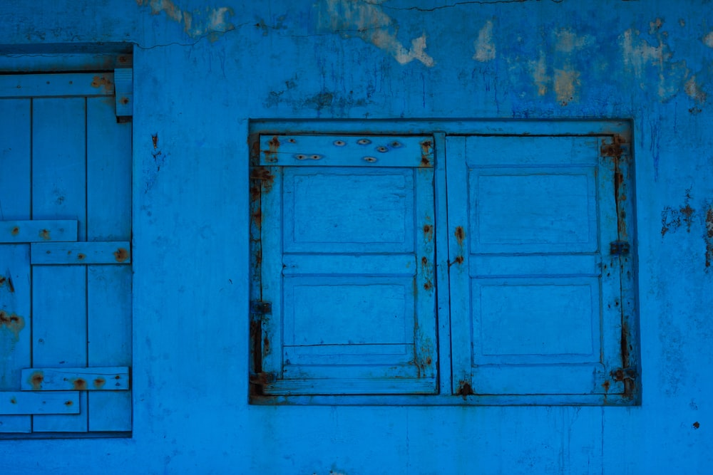 blue painted wall with window