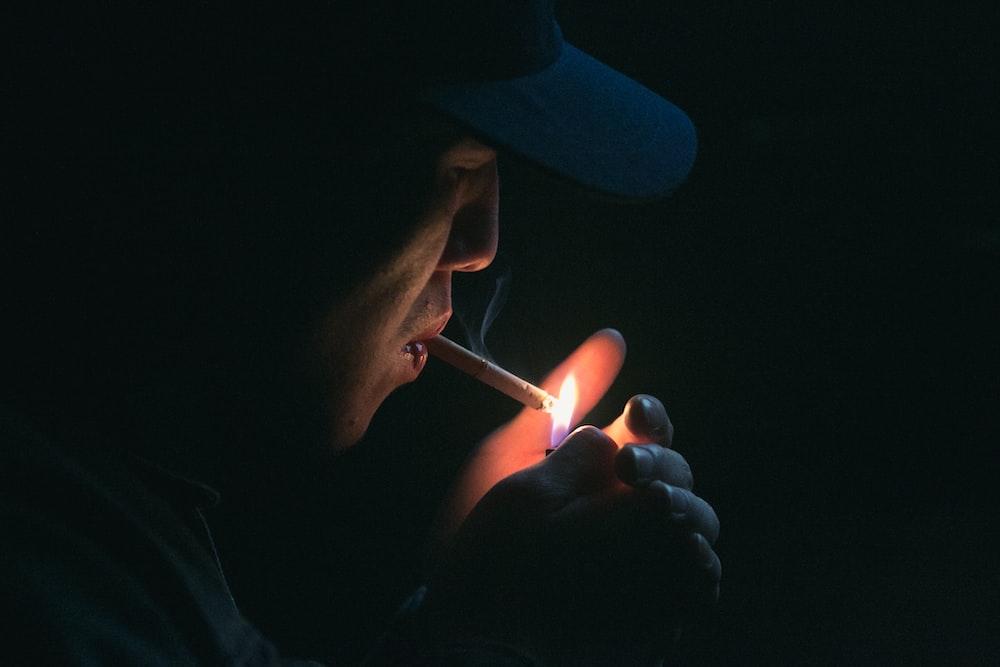 man lighting his cigarette