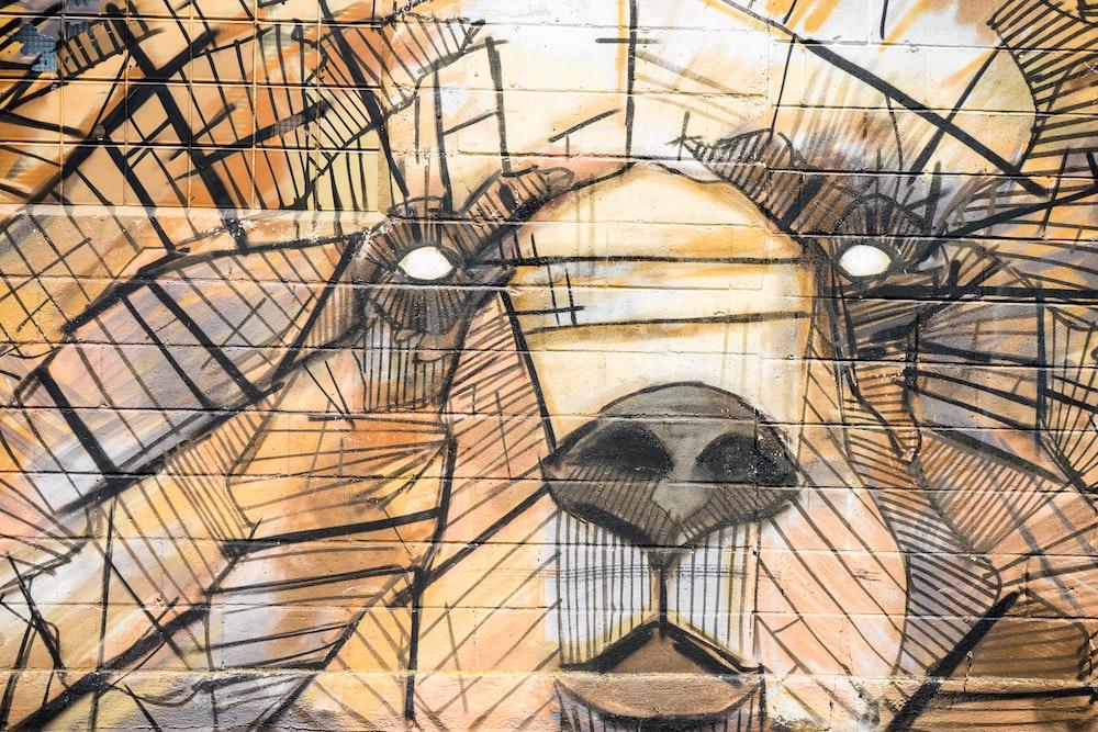 Textured street art of a bear's face