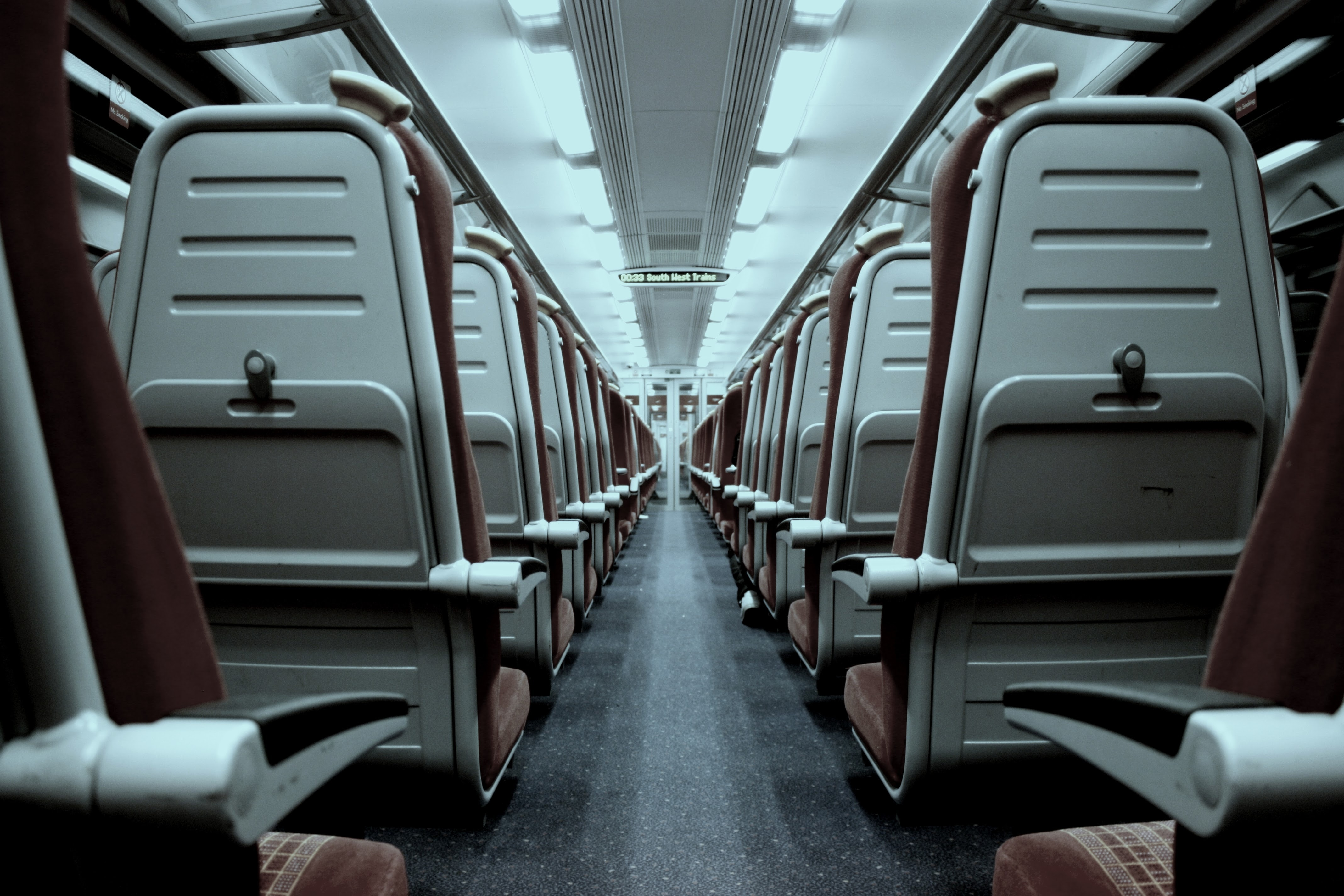 View from the back of the aisle in an empty train