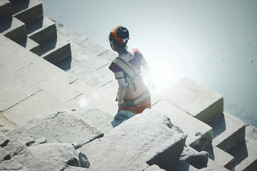 woman standing on concrete platform