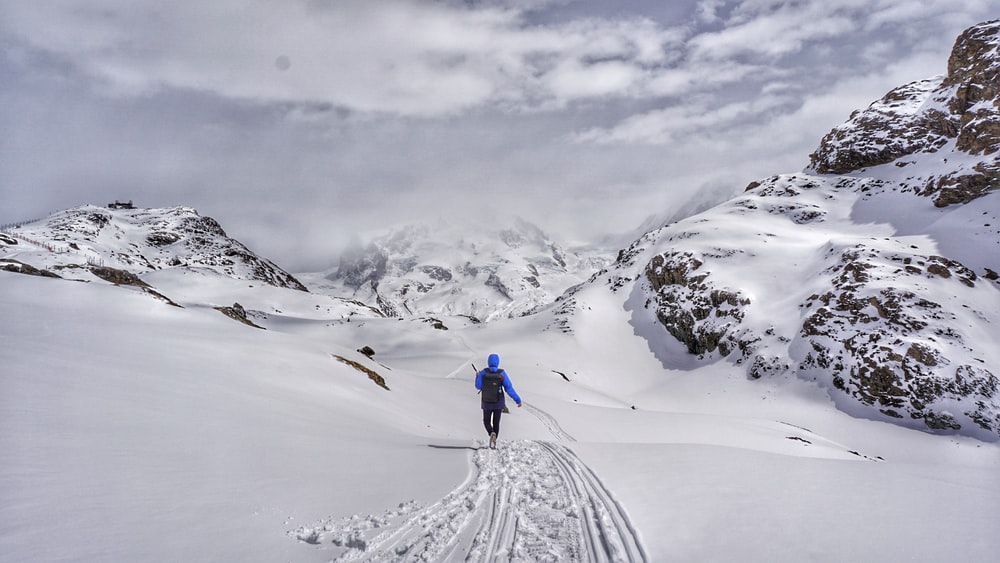 person walking on snowy mountain