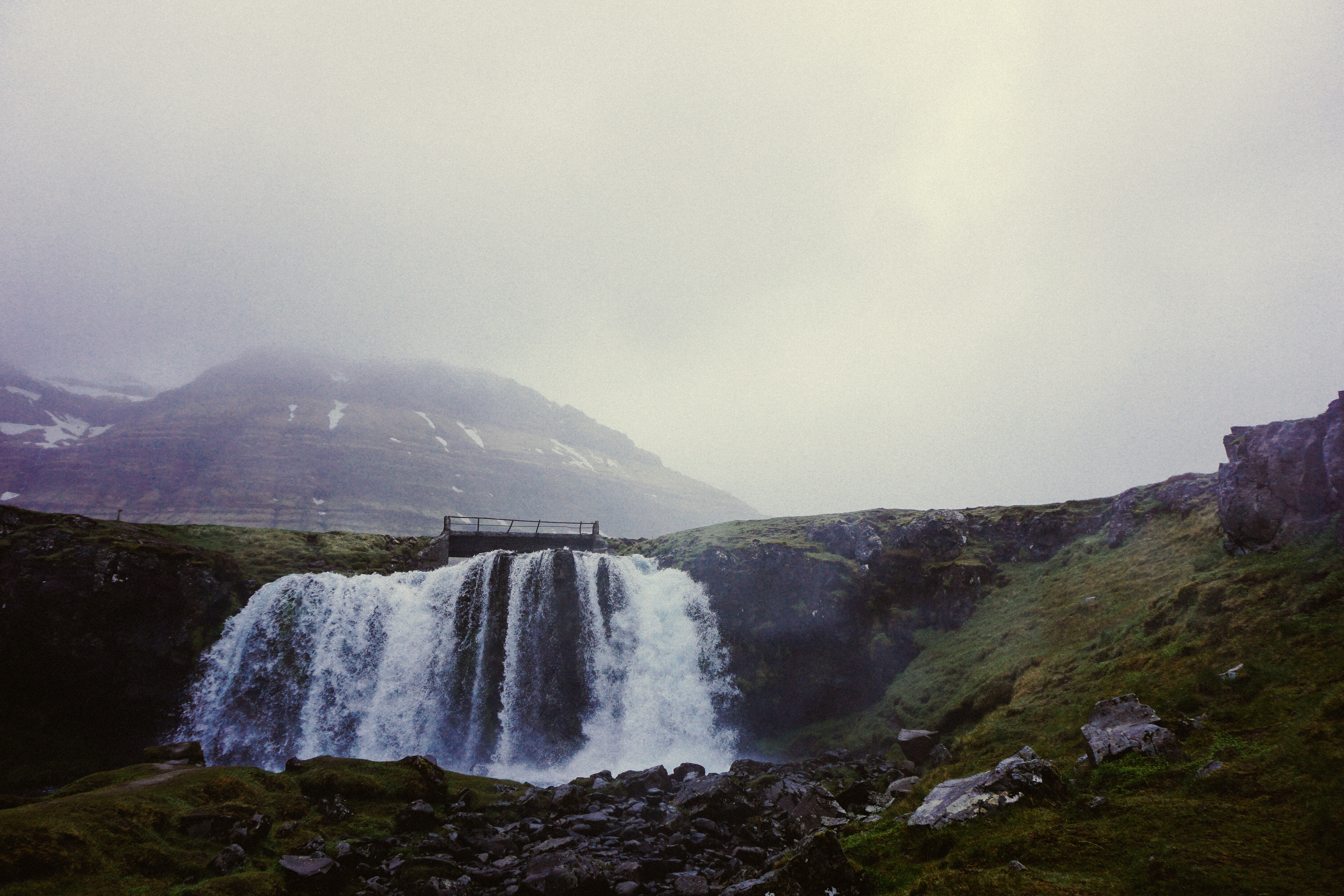 Calm waterfall on a mossy hillside in Iceland