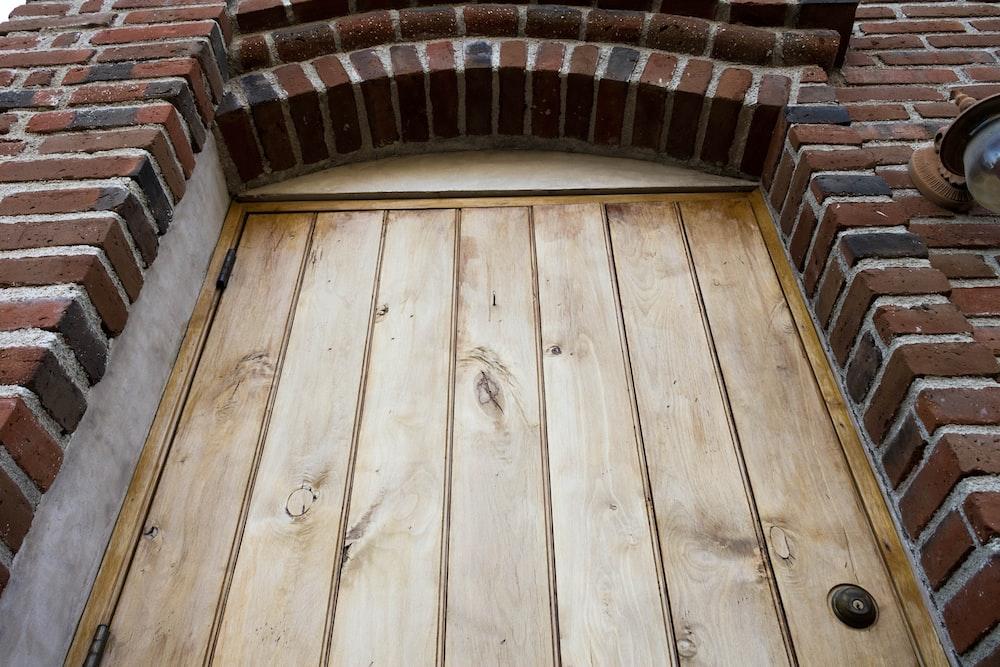 closeup photo of brown wooden door