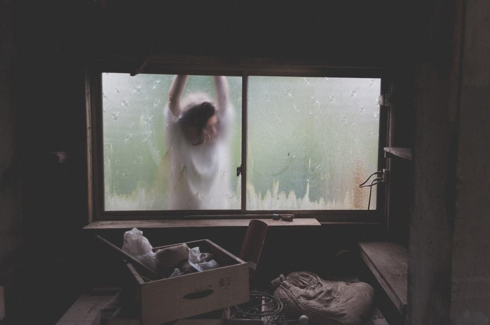 woman leaning on window