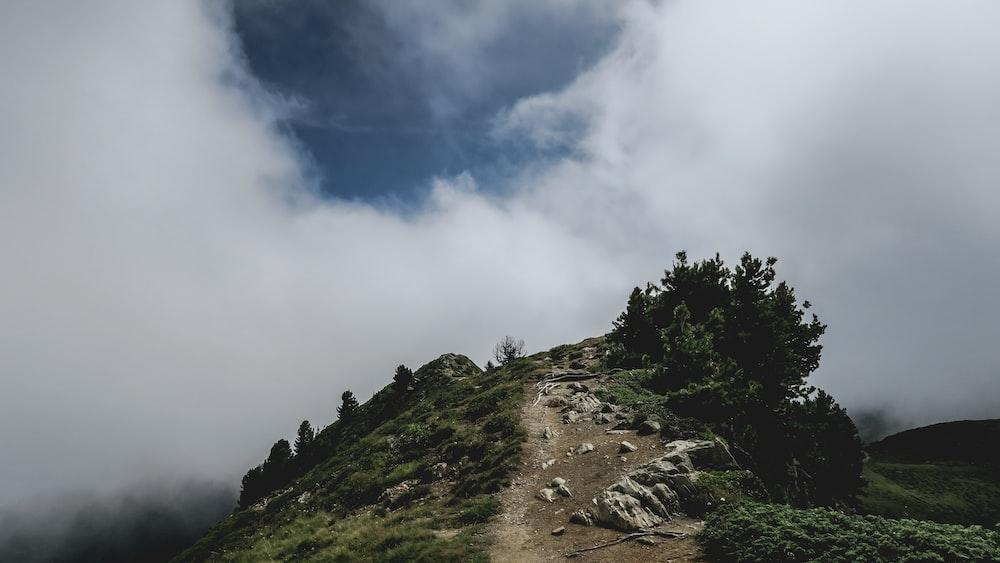 green mountain near white clouds