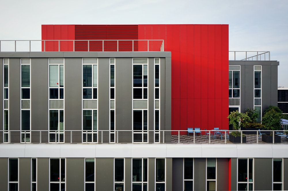 aerial photography of red and gray building