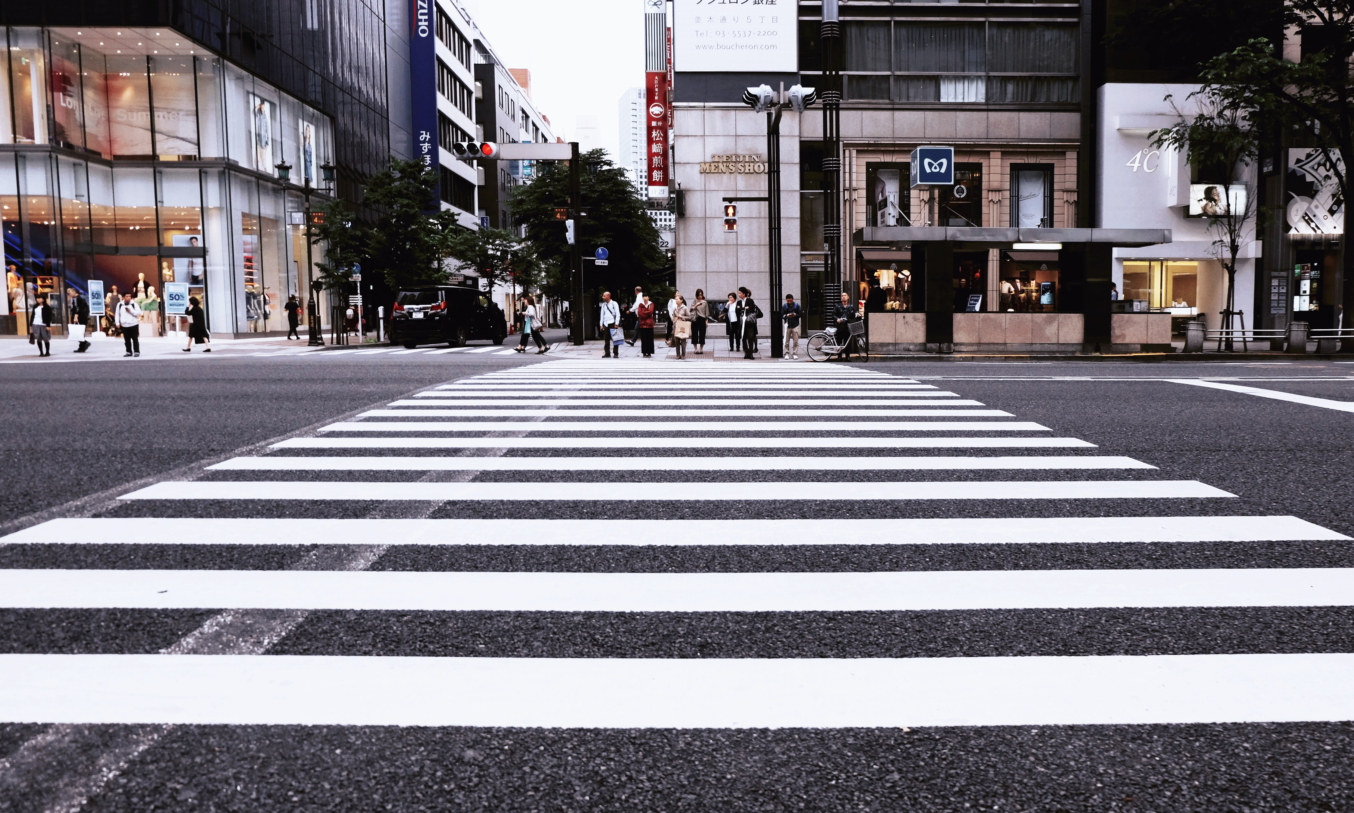 Pedestrians waiting to cross the street in Tokyo