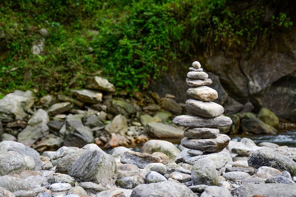 shallow focus photography balance stones