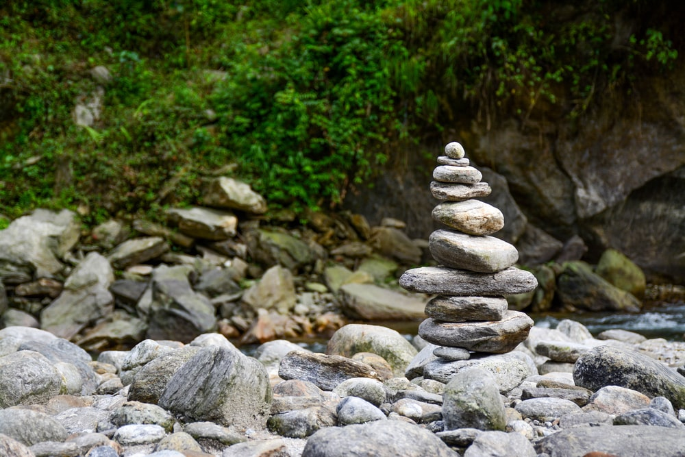 shallow focus photography balance stones