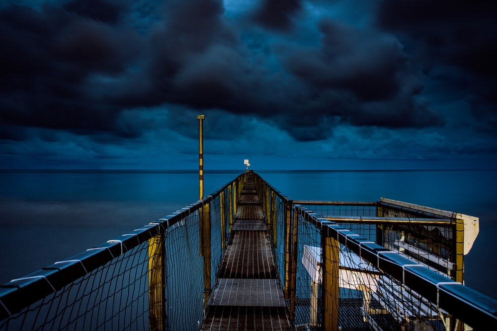 photo of bridge with fence