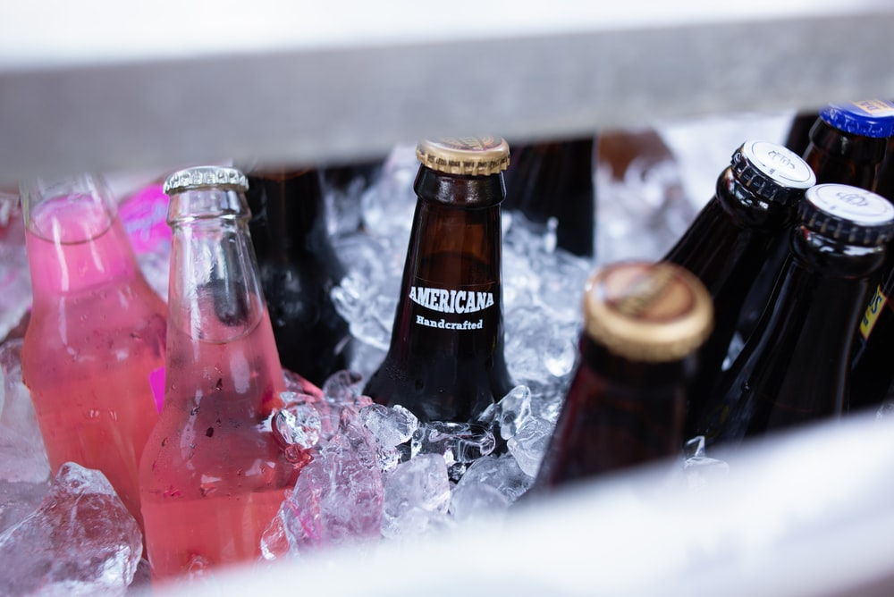 clear labeled bottles in cooler box