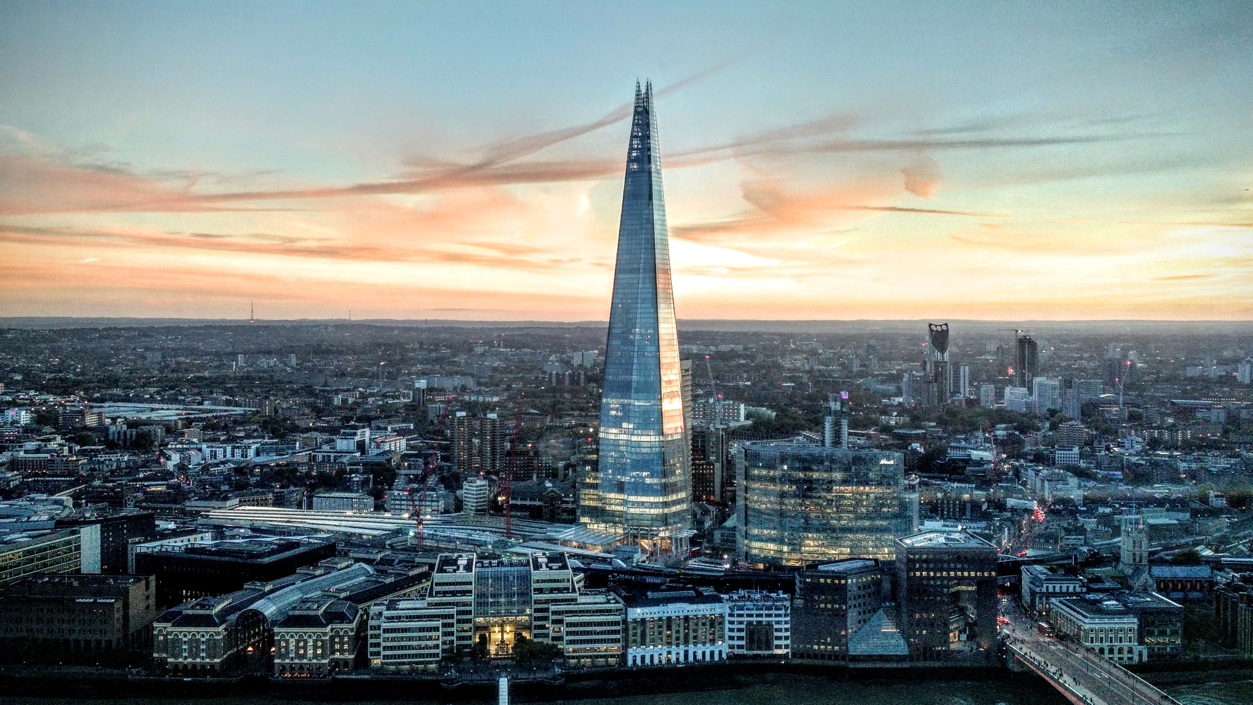 The Shard skyscraper against the skyline of London during sunset