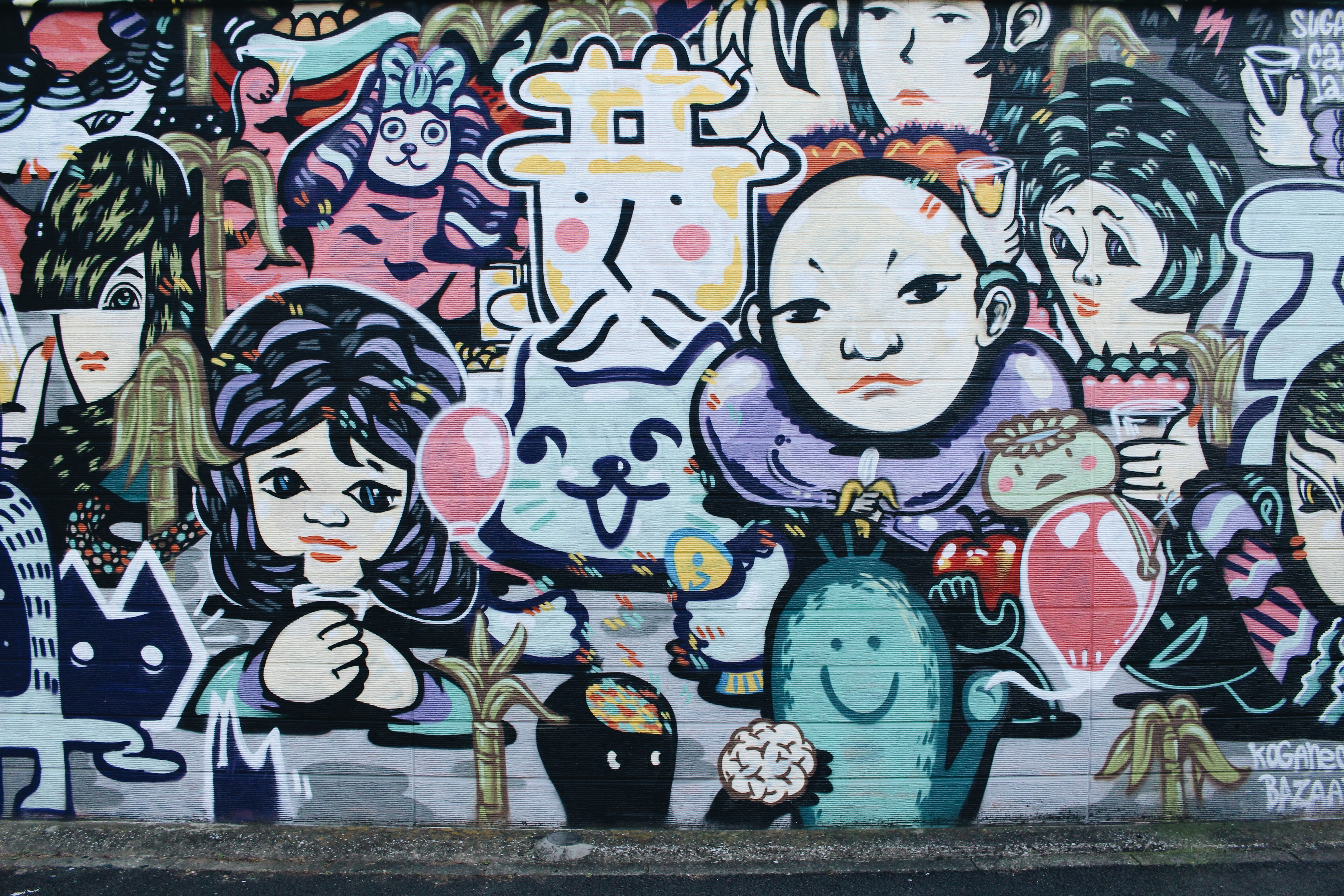 A group of cartoon characters painted on a wall mural.