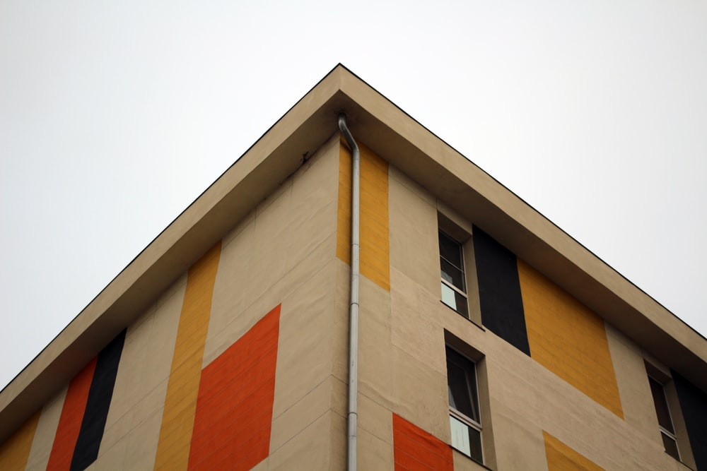 beige and red concrete building facade