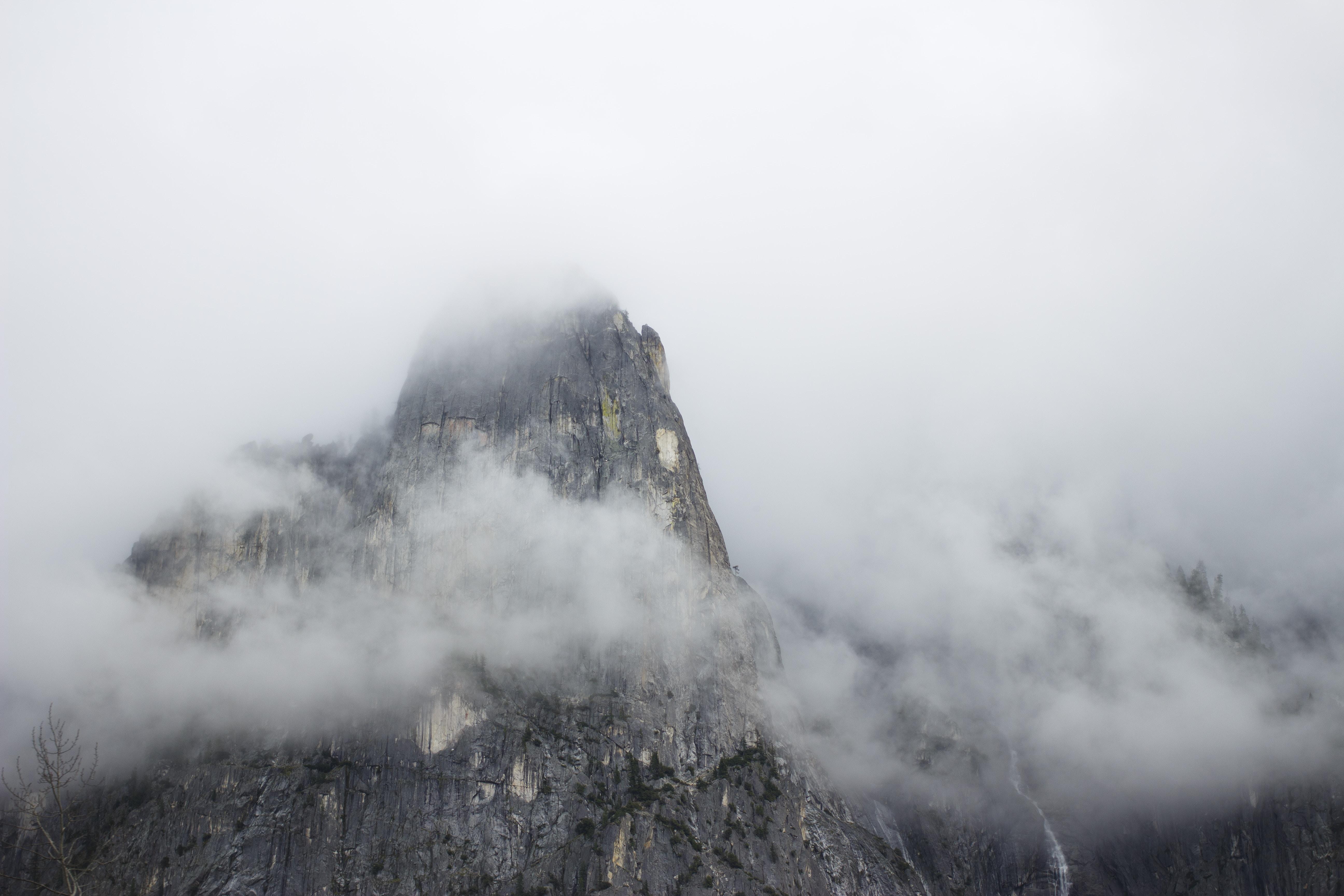 Rocky mountain peak in Yosemite on a  foggy day