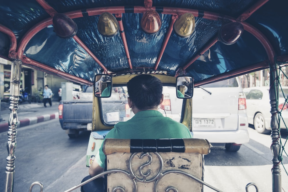 man driving rickshaw